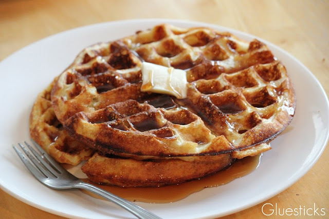 crispy waffles with syrup and butter on plate