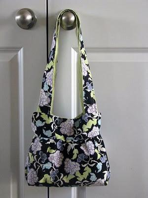 small handbag with purple floral fabric