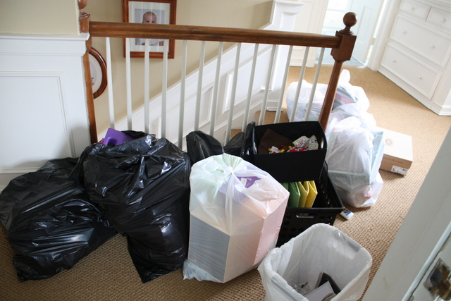 bags of items to throw away or donate