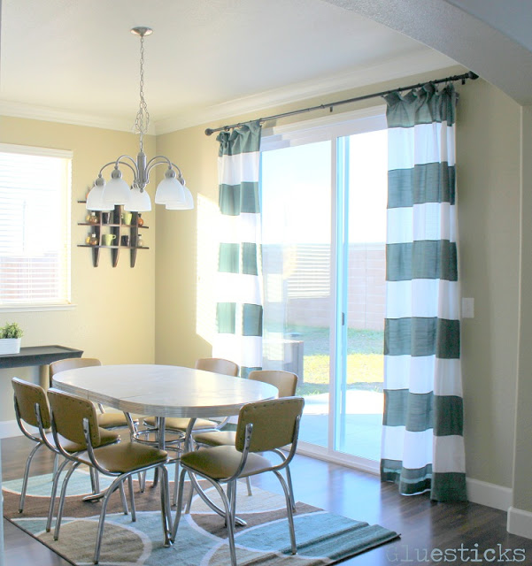 grey and white horizontal striped curtains in dining room