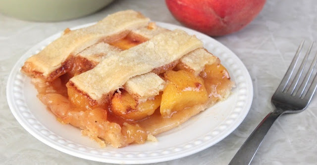 "Old fashioned peach cobbler is a mix between a cobbler and a deep dish pie. Baked in a 9 x 13"" baking dish, it's big enough for the whole family!"