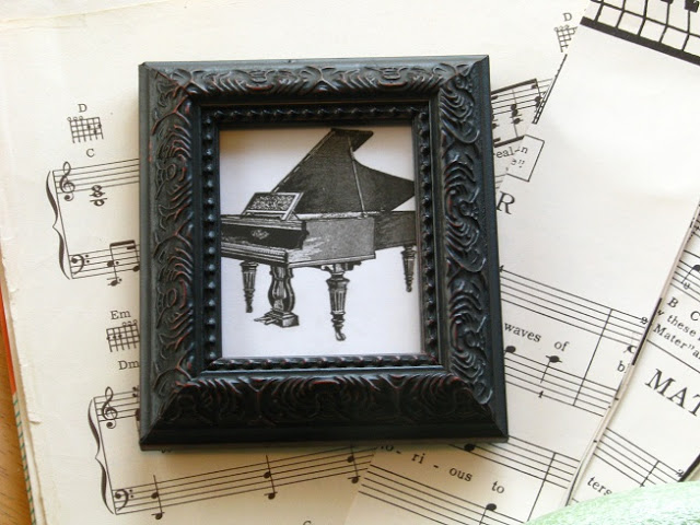 small framed image of piano