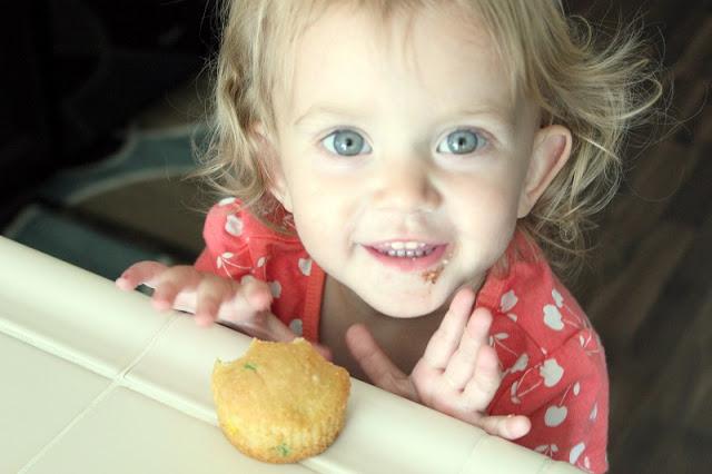 toddler with cupcake