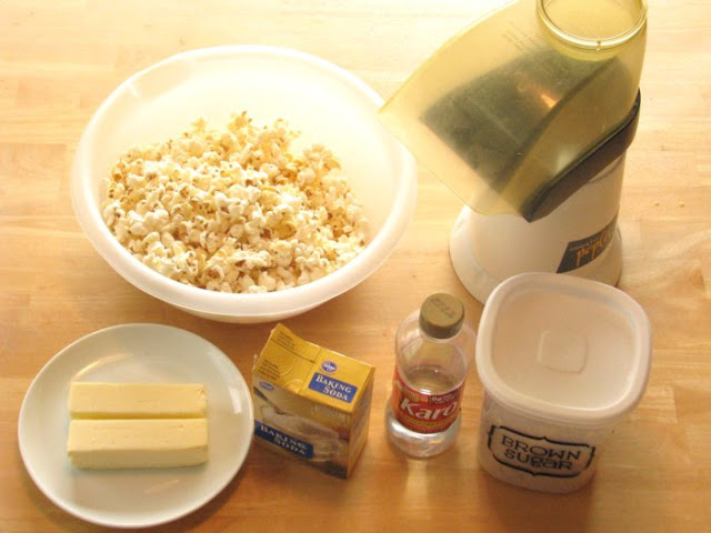Hands down the BEST caramel popcorn recipe you will ever come across. After the buttery caramel is poured over the popcorn it is baked in the oven for an hour. The fact that it is Paula Deen's recipe certainly helps. After all, it starts out with a stick of butter.