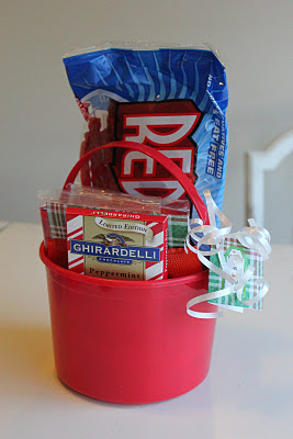 red bucket with popcorn red vines and chocolate inside