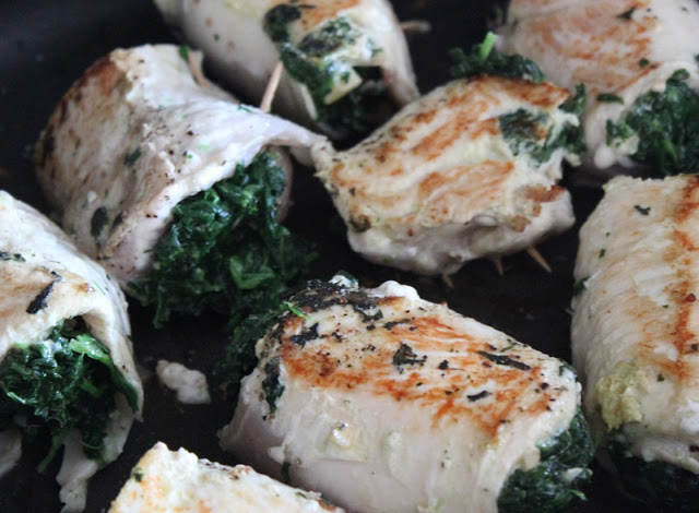 chicken breasts seared in pan with spinach