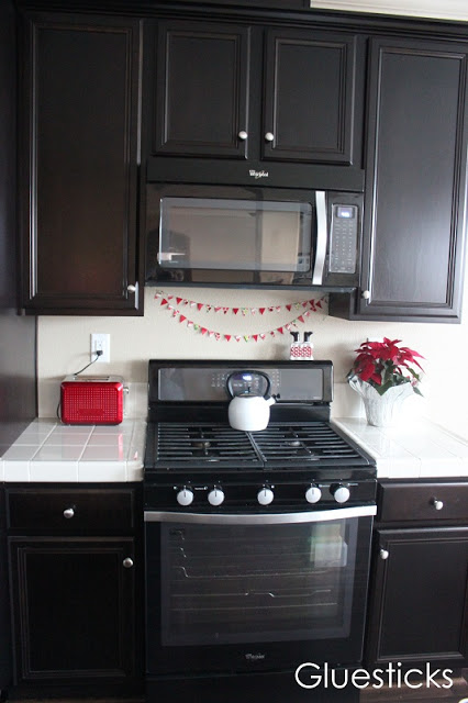 duct tape bunting draped on kitchen wall