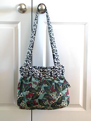 green and black floral fabric handbag