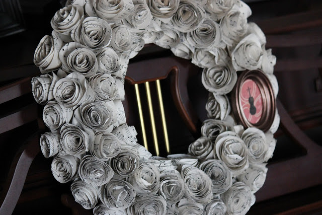 violin sheet music wreath on piano