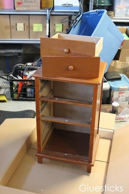 unpainted wooden file cabinet