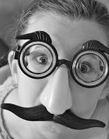 child wearing goofy spy glasses