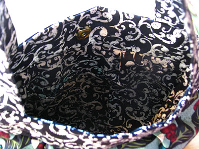 inside handbag showing lining and pockets
