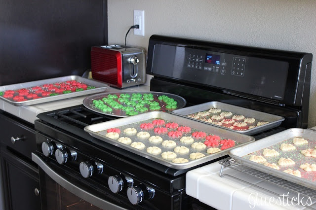 stove with trays of cookies on it