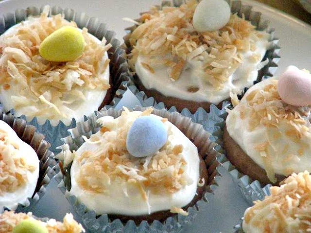 coconut cupcakes with chocolate eggs on top