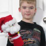 child holding potato chip santa