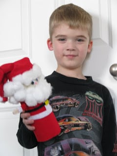 child holding potato chip santa