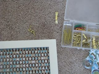 box of hardware to hang up framed jewelry holder