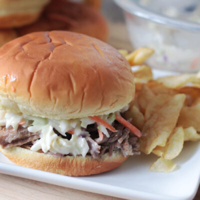 North Carolina pork sandwich with chips on plate