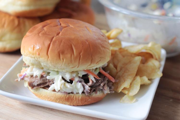 North Carolina pork sandwich with chips on plate