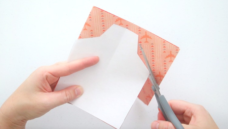 scissors cutting around shirt shaped template