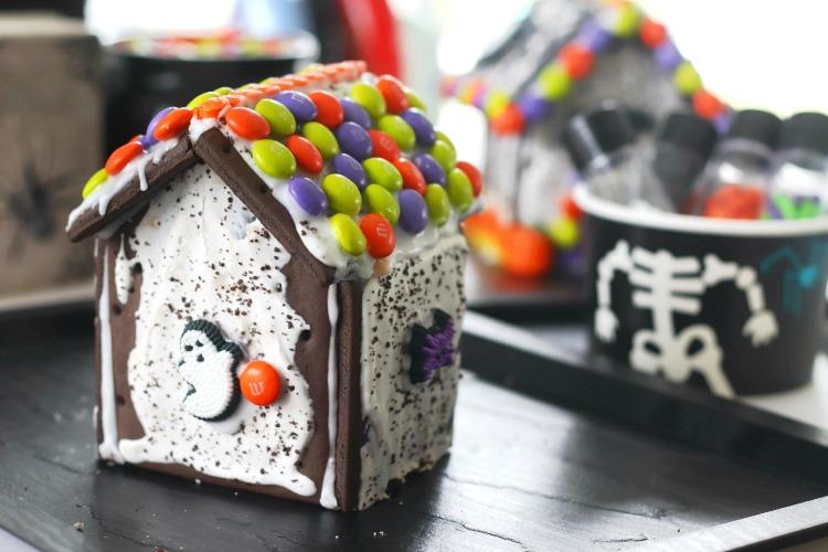 pop tart haunted gingerbread house on black tray