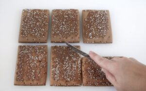 pop tart being cut on a diagonal for roof piece