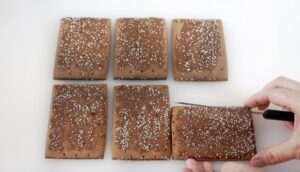 6 pop tarts being cut into gingerbread house shapes