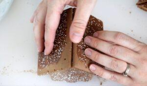 hands holding pop tart house roof together