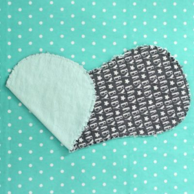 burp cloth on teal background