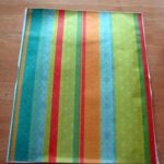 rainbow striped scrapbook paper adhered to contact paper