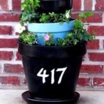 tiered terracotta planter on porch