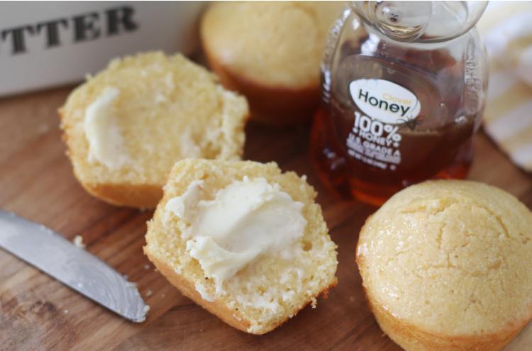 honey glazed cornbread muffin cut in half with butter