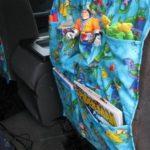 car seat organizer hanging on back of seat