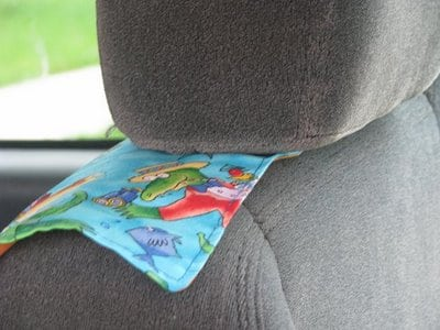 car seat cover tucked under head rest