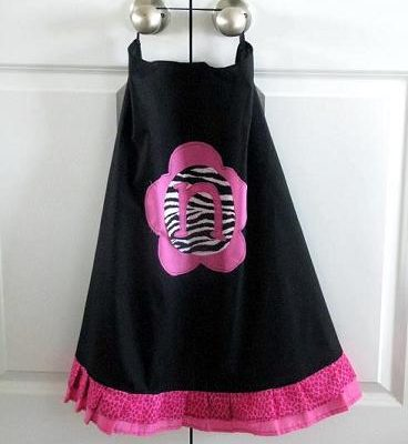 black cape with pink ruffle