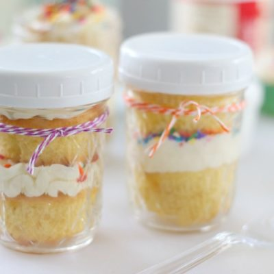 2 jars with cupcakes inside and white lids