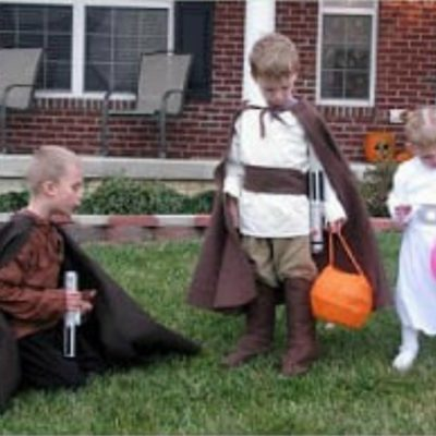 children wearing star wars costumes