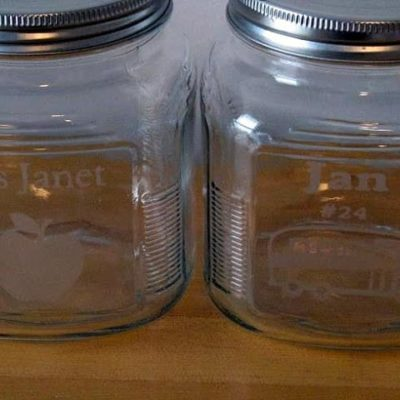 two jars with acid etched designs on front
