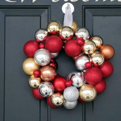 ornament wreath hanging on black door
