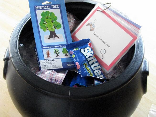 plastic black cauldron filled with science kits