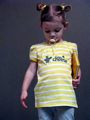 girl wearing yellow shirt with mouse painted on front