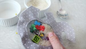 i-spy bag filled with rice and toys and pinned closed