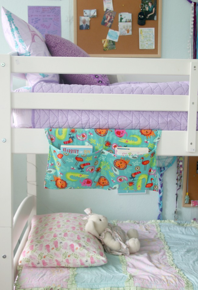 bunk bed with book caddy hanging off top bunk