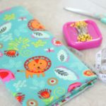 fabric, pins, measuring tape and scissors