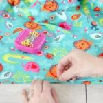 hand pinning fabric with straight pins