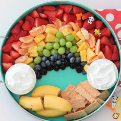 fruit platter in teal tray with red napkins