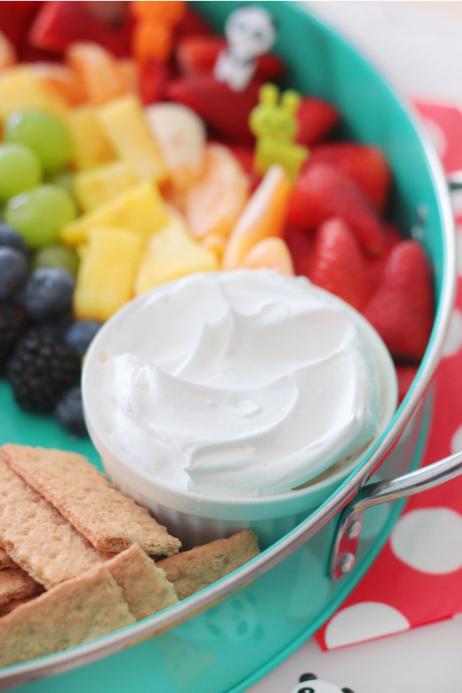 graham crackers and cool whip with fruit platter