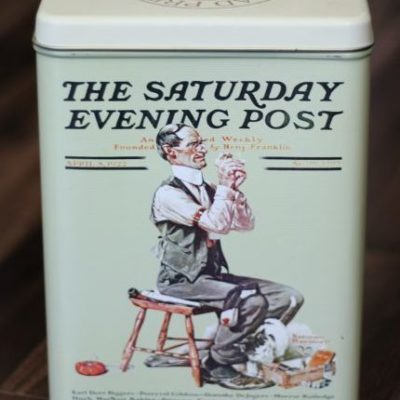 Saturday evening post themed tin