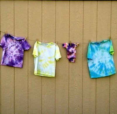 tie dyed shirts hanging on clothesline