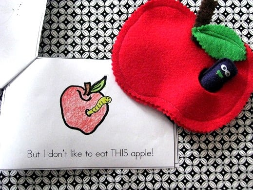 paper apple book for kids next to felt apple